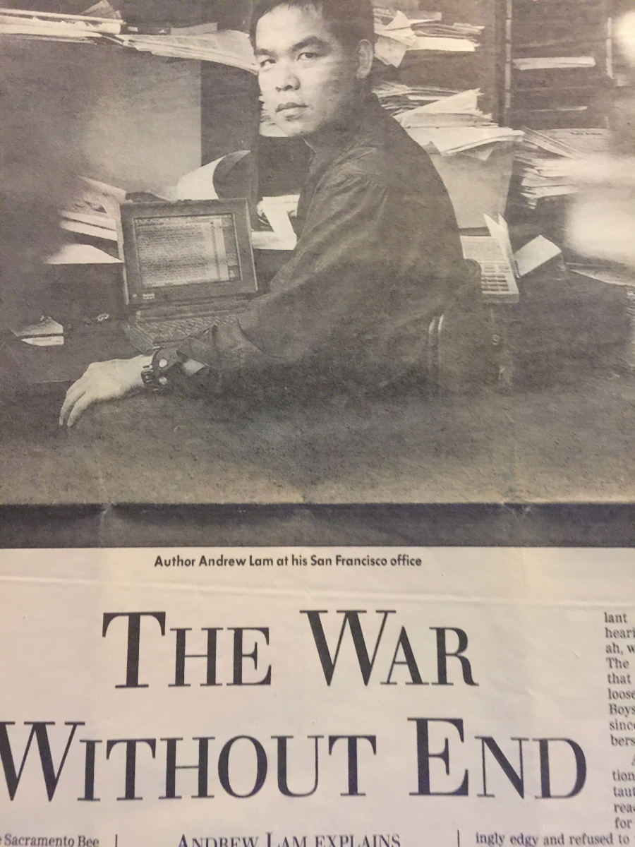 Newspaper clipping with photo of man, in black and white, sitting at desk and beginning of essay below