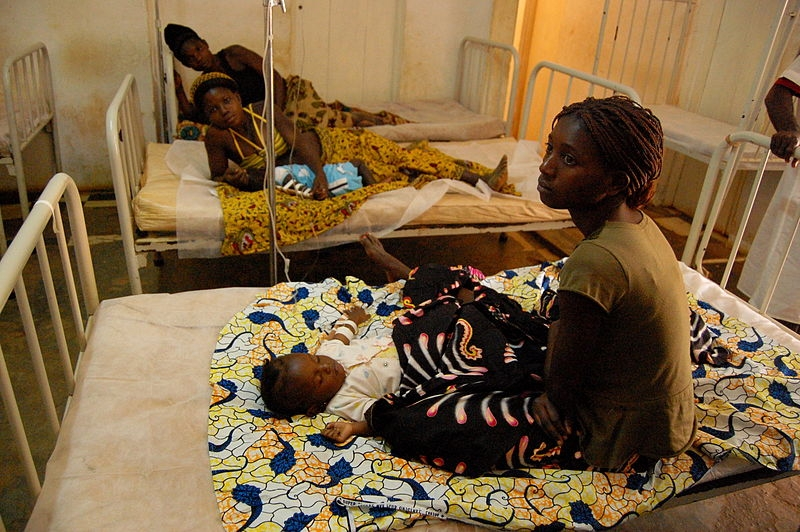 Women wait by their sick babies while they receive treatment for malaria in municipal hospital of M'banza-Kongo, the capital of Angola's northwestern Zaire Province, in 2006.
