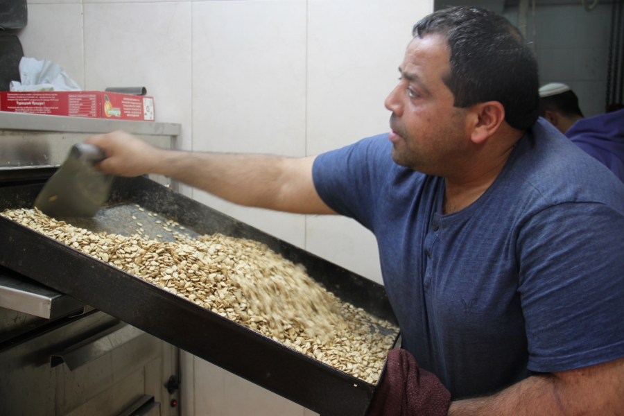 Mohammed Shehada roasting watermelon seeds at Kahana Nuts. He has 30 years in the nut business.