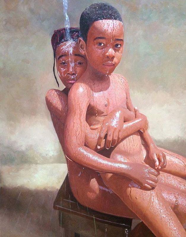 Boy sitting on girl's lap.