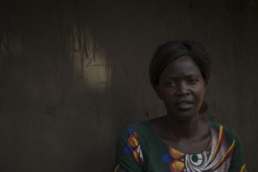 Lily Atong in front of her home in Gulu, Uganda.