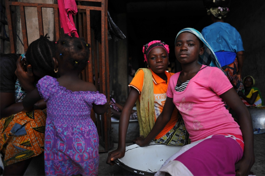 Two young girls work as kayayei in Accra's markets.