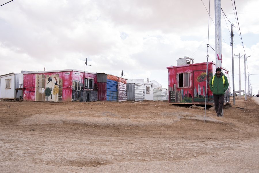 Murals adorn older metal shelters in the camp, part of art initiatives run by aid organizations for children in the camp.