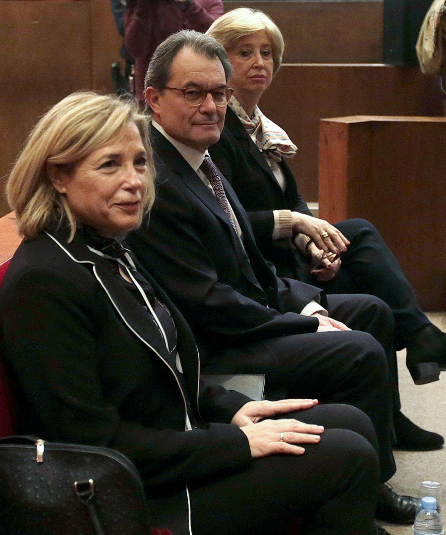 Former Catalan President Artur Mas, center, sitting in court on trial in Barcelona, Spain, on Feb. 6.