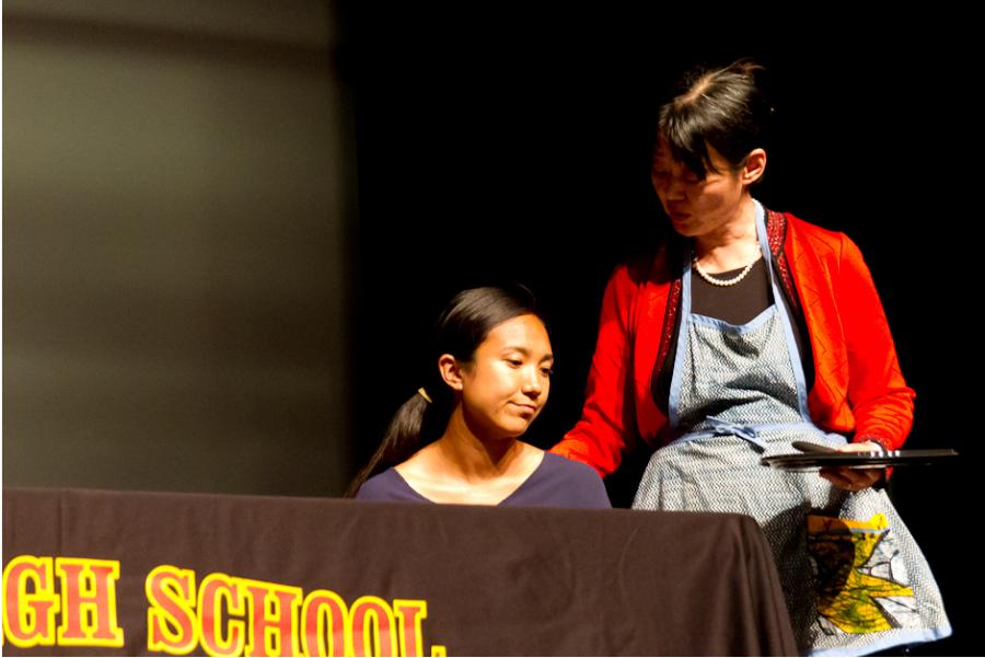 Hu places her hand on Nash's shoulder, on stage