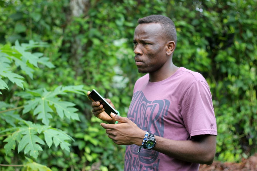 Aziz with his smart phone at the Manus Island detention camp on Papua New Guinea. The smart phone is his link to the outside world and how he sends WhatsApp audio messages to Michael Green.