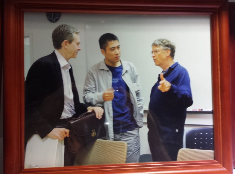Wang Jun, former BGI Chief Executive, with Bill Gates, in photo displayed at BGI