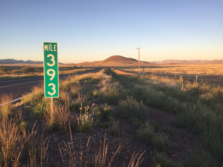 A mile marker on an empty highway