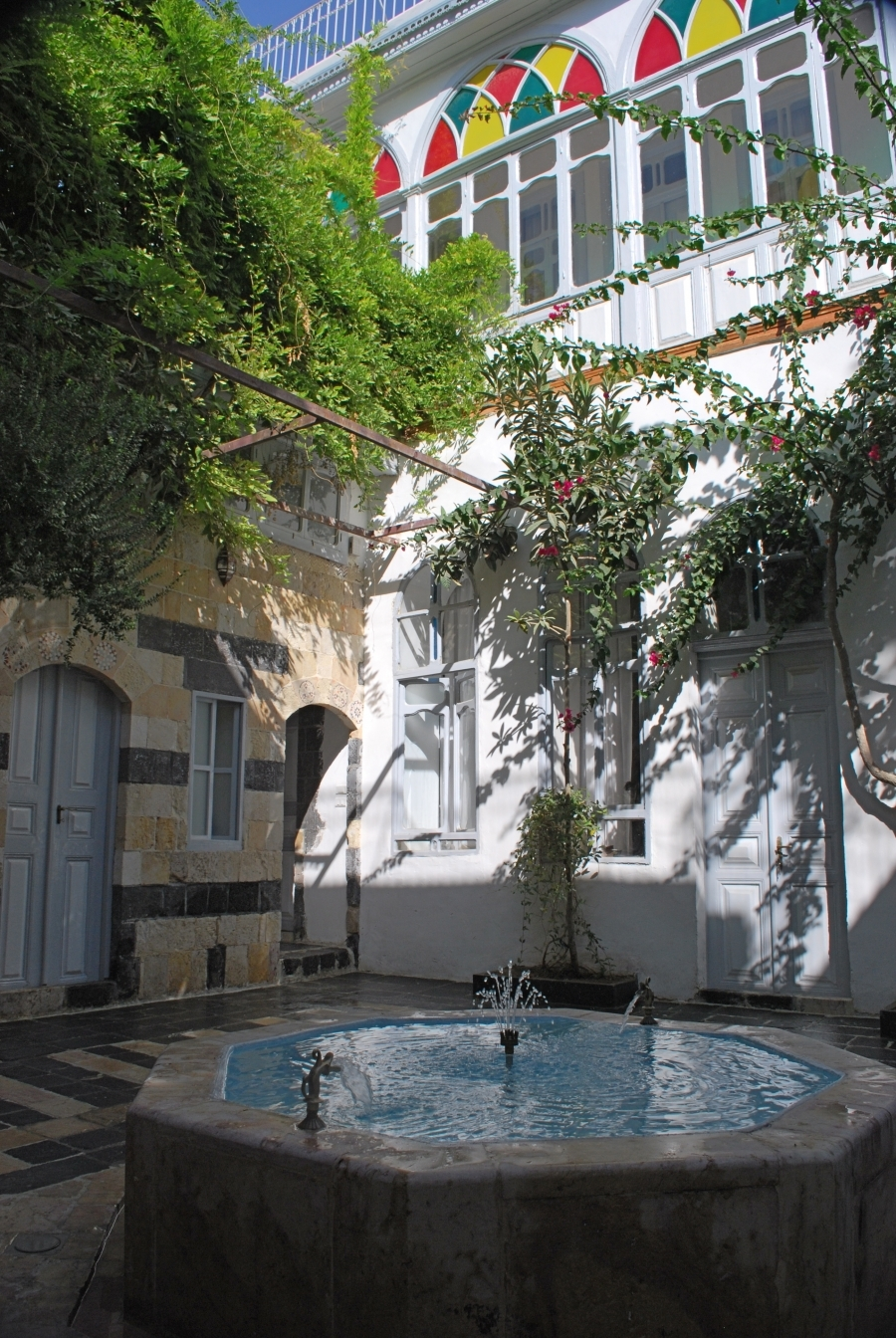 Bait Baroudi courtyard with fountain working, view towards the northern 19th century facade.