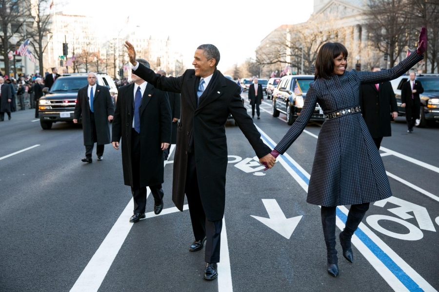 President Barack Obama and Michelle Obama walk in the inaugural parade on Pennsylvania Avenue on January 21, 2013.