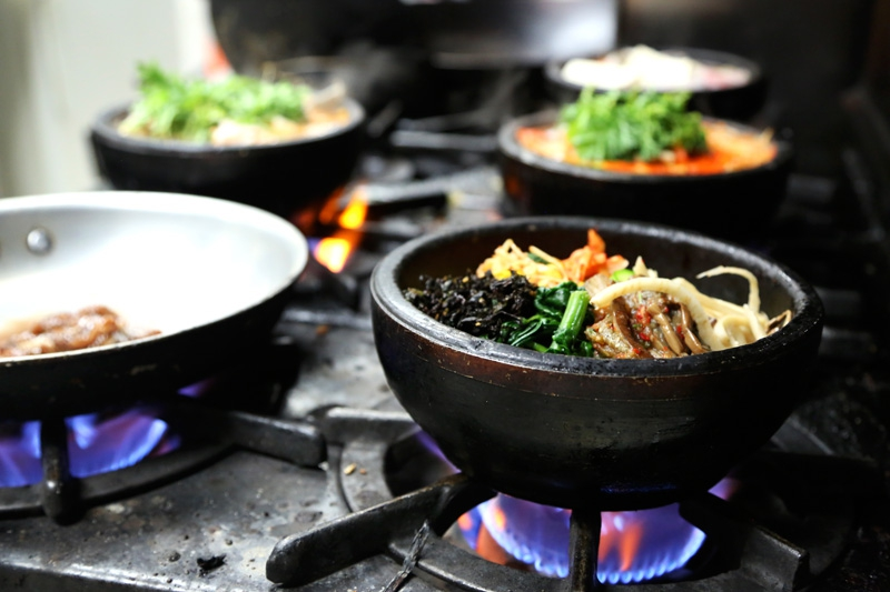 Many of the Korean dishes at Koreana are cooked and served in a hot stone bowl. Hyosun Tartaglia says her military customers who've served in Korea can handle her spiciest dishes.