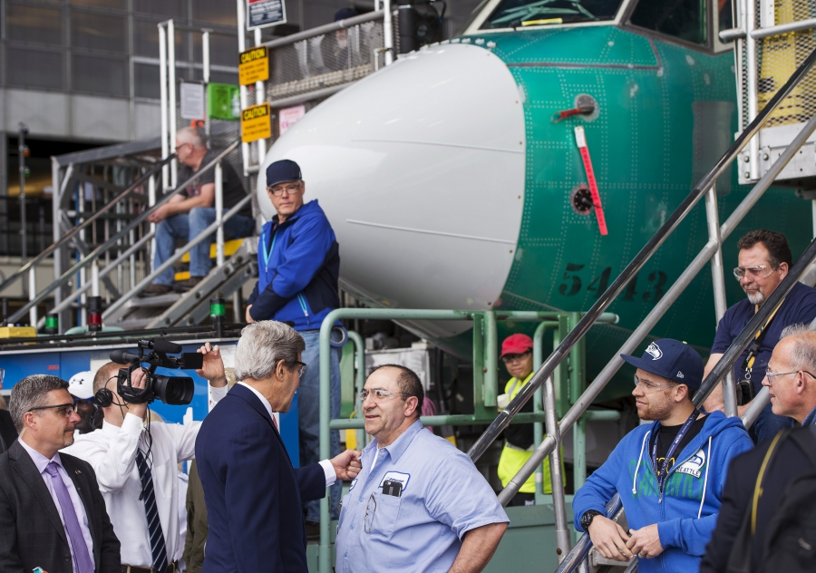 U.S. Secretary of State John Kerry greets employees at Boeing's 737 airplane factory for a trade speech on the Trans-Pacific Partnership (TPP), in Renton, Washington. Aviation is one of many US businesses proponents say will be strengthened by the TPP.
