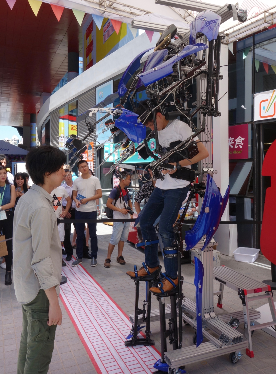 Stepping into a robot suit at the 2015 Shenzhen Maker Faire