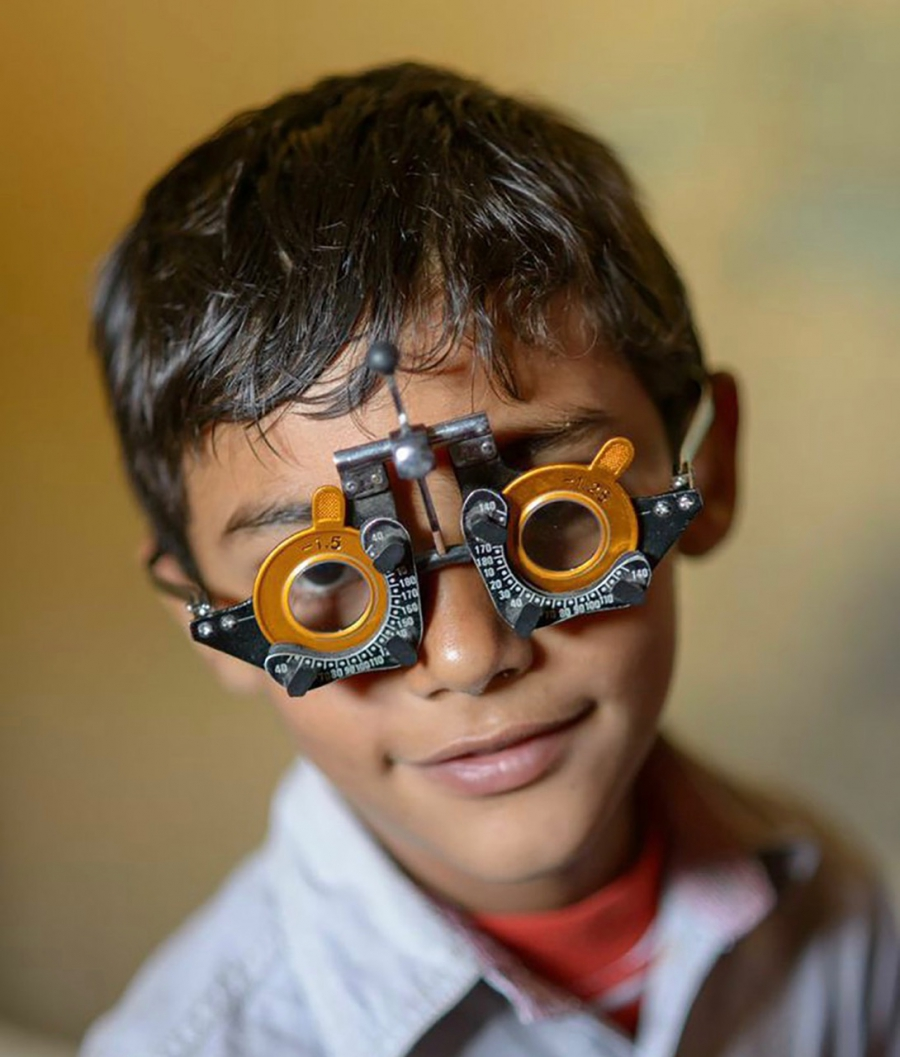 Boy takes a vision test, as part of VisionSpring's efforts to reach people in remote areas who need glasses.