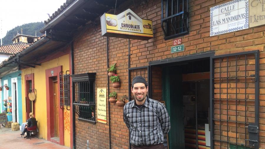 "Gustavo, a Venezuelan, runs a restaurant in Bogota. ""Ten years ago there was only one [Venezuelan] arepera [in Bogota]. Now, they are everywhere,"" Cruz says."
