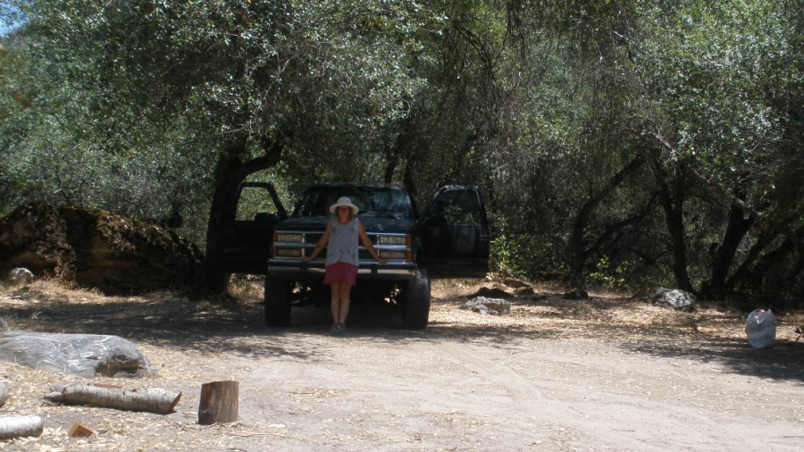 Kate White in front of the pickup truck she's driving to the site of the new Herland in South America.