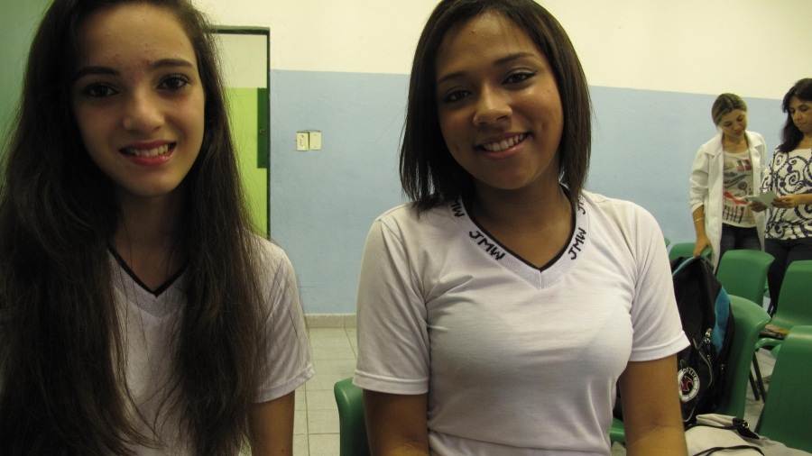 Sarah Campos (left) and Juliana Santos, former students of the Leão Machado School. Campos says she tried her first radish after working in the school garden. Now she loves them.