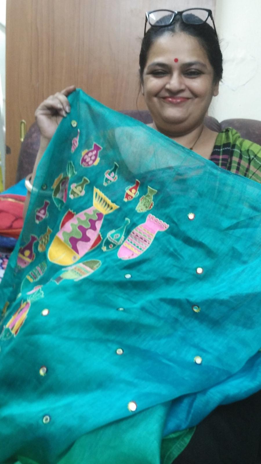 Deepa Mehta takes old saris and jazzes them up.