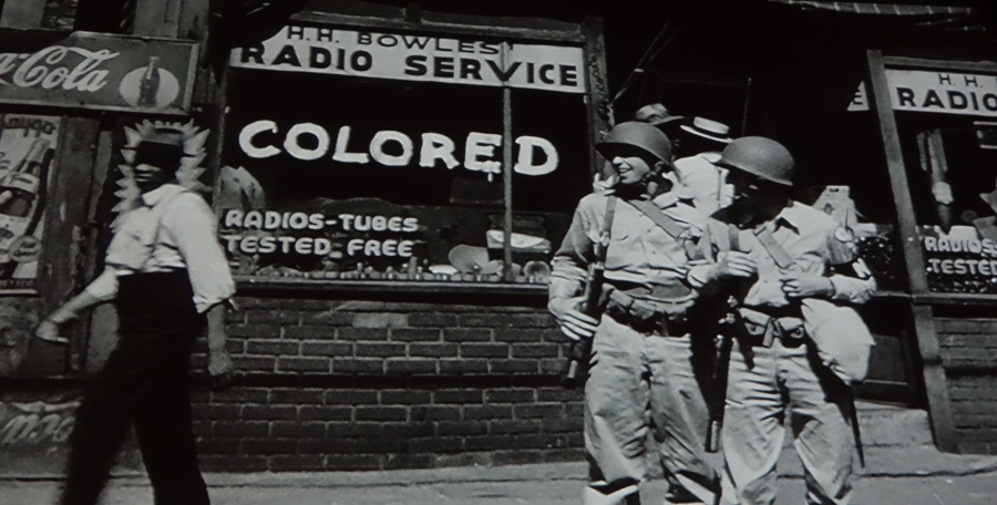 Street scene of GIs and African-American during World War II, from film at Rosie the Riveter Museum, Richmond, CA