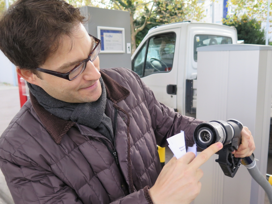 Alexander Conreder of the German utility ENBW holds a hydrogen fuel pump at a fueling station in Stuttgart. Backers of green hydrogen are hoping to make the transition from traditional fuels as easy as possible for consumers.
