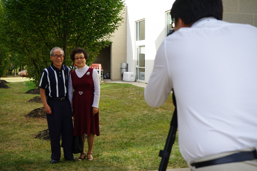 A couple poses for their graduation photo at the Duranno Father School.