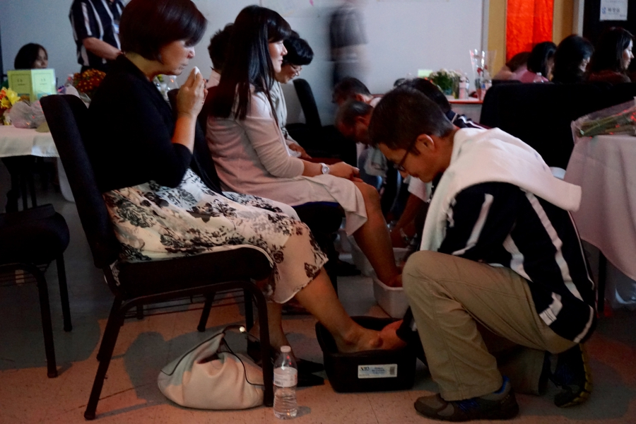 At the Father School graduation, men wash their wives' feet, just as Jesus washed the feet of his disciples in the Bible.