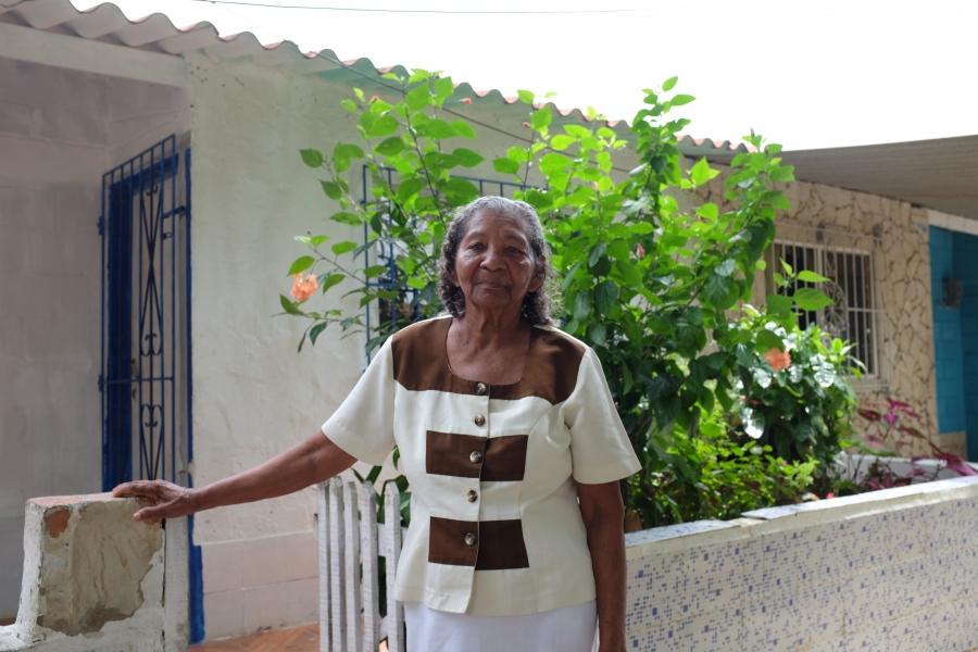 Matilde Isabel Pajaro de Ferias stands in front of her home in the City of Women.
