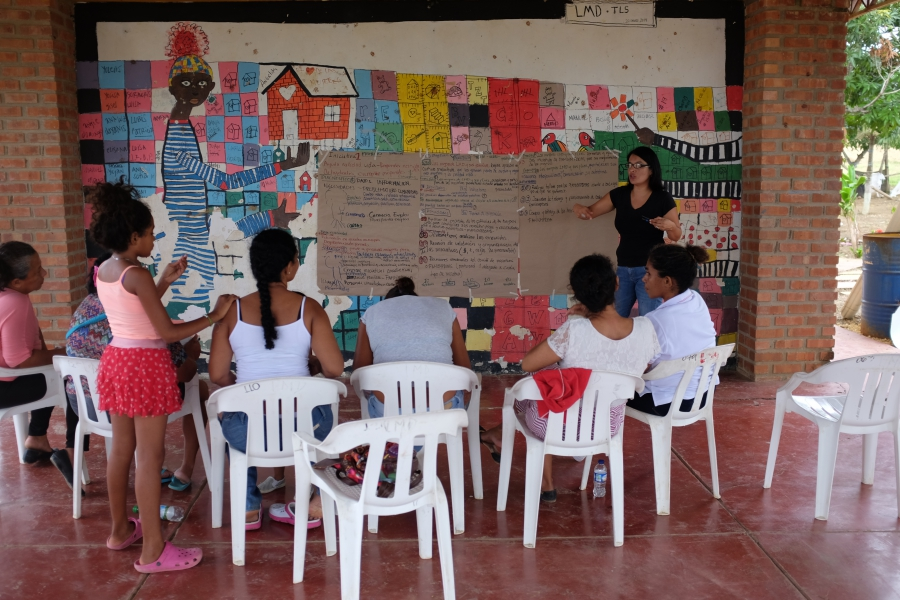 Residents of the City of Women attend a workshop at the community center.