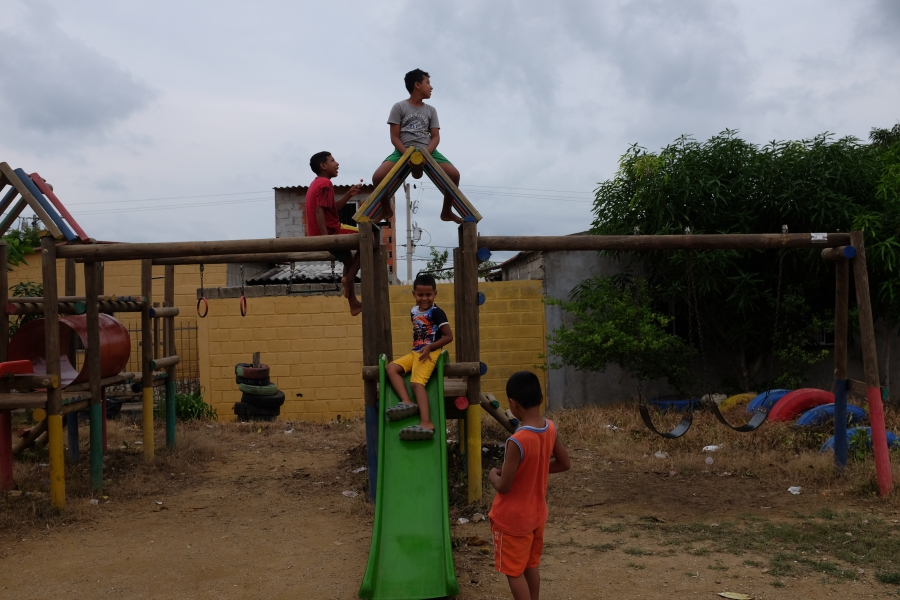 Children play on a playground in the City of Women.