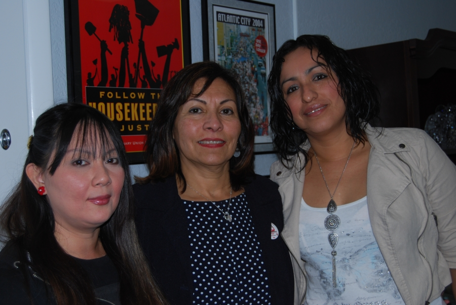 Cosmopolitan workers Katherine Valotro (left) and Yanet Nuñez (right), with Geocando Arguello Kline head of the Culinary Union.