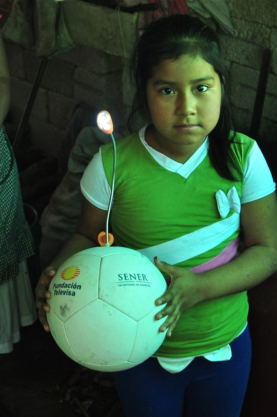 Dora Natalia Antonio Ramos, 7, was the only Soccket recipient interviewed whose ball and lamp still worked well.