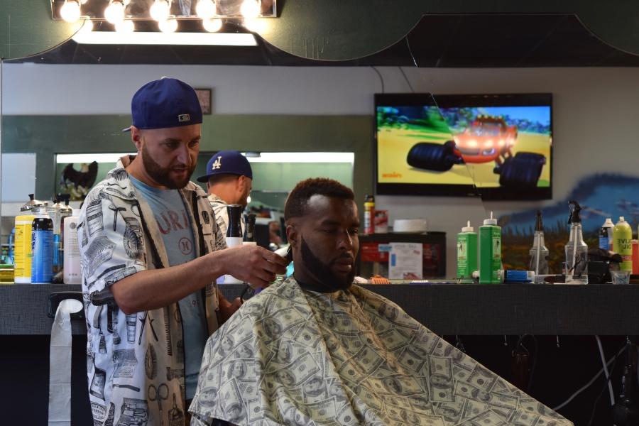Hassan at his barbershop in Lincoln, Nebraska