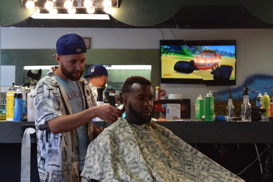 Hassan at his barbershop in Lincoln, Nebraska