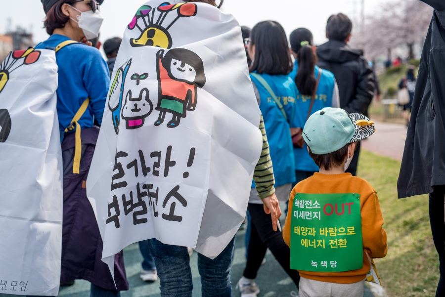 Families took part in an anti-nuclear protest led by Catholic clergy outside of Seoul in April 2017.
