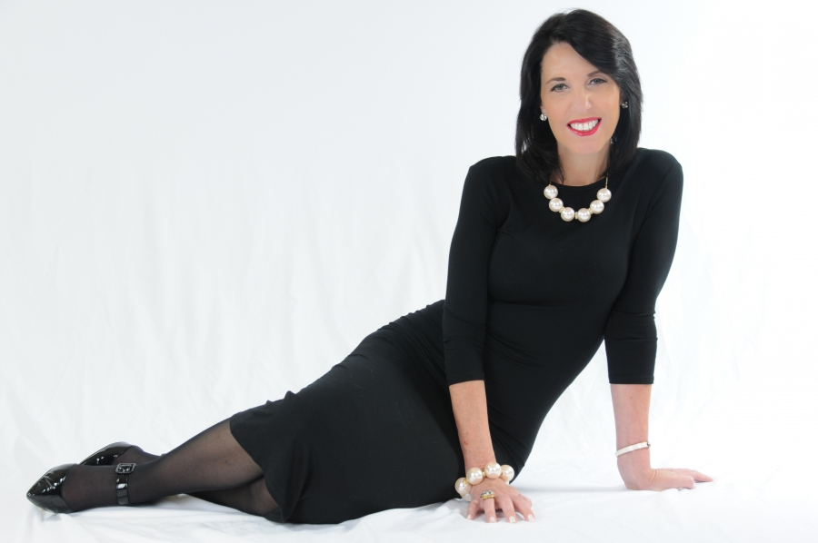 Dr. Marlene Wasserman, known to her listeners as Dr. Eve. laying down wearing a black dress