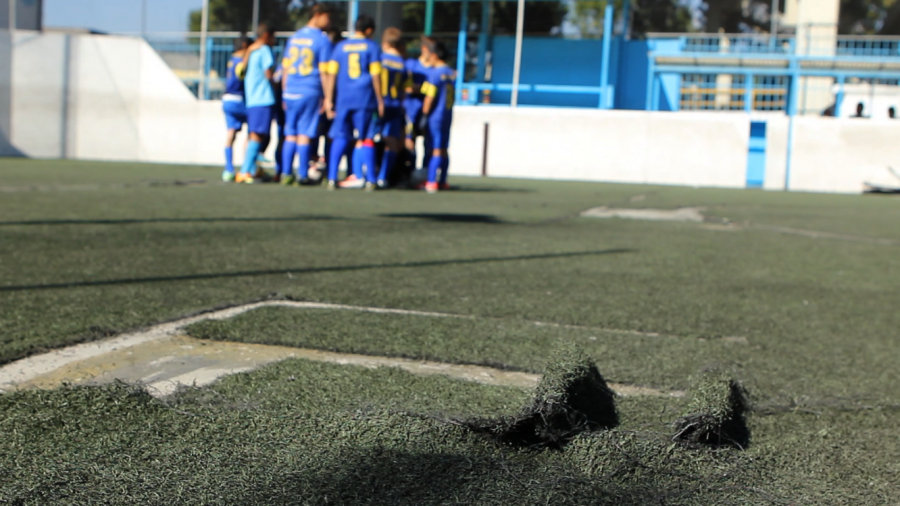 Many boys in Mexico City play soccer on small urban fields, concrete courts papered over by synthetic turf.