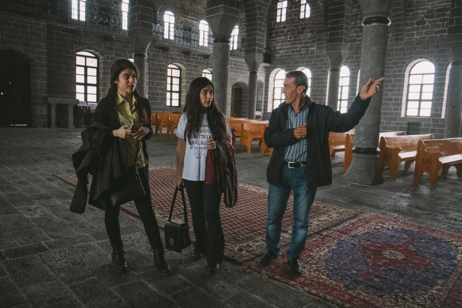 Ermen Demircian, caretaker of the Surp Giragos Armenian church in Diyarbakir, guides visitors during the lead up to the centennial memorial of the genocide.