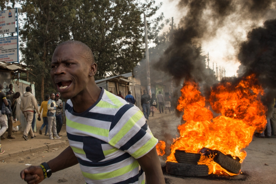 """Uhuru must go!"" yells a demonstrator in Kibera, an informal settlement in Nairobi, Kenya. The man blamed current President Uhuru Kenyatta for the lack of jobs and widespread poverty in the area, and demanded that the President step down from office."