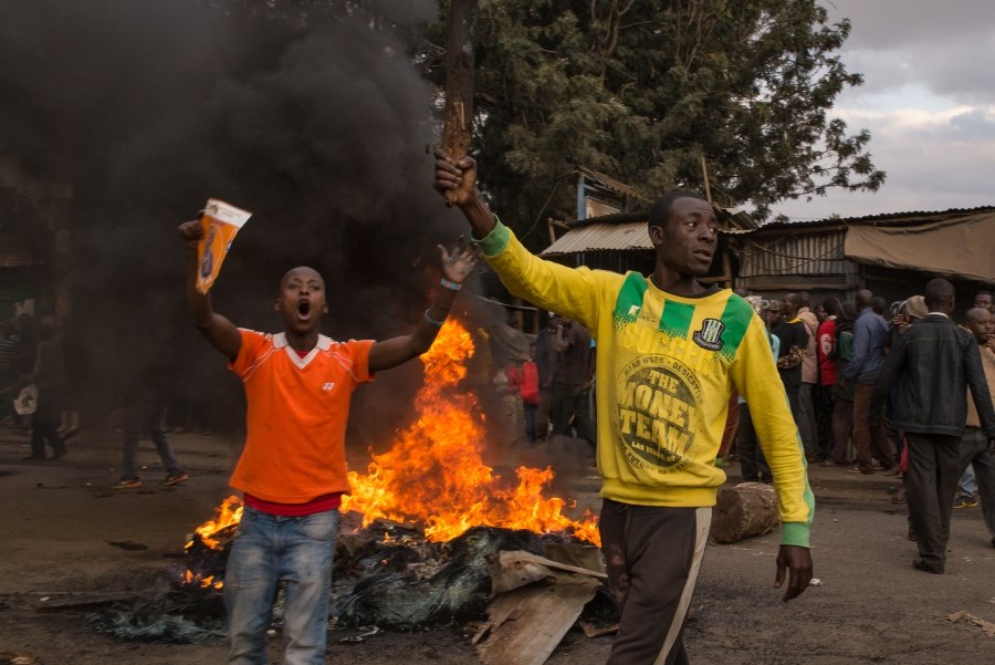 Men holding stones demand current President Uhuru Kenyatta step down from office. The demonstration came one day after Kenyans went to the polls to elect their next president.