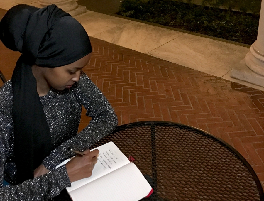 Amal Hussein writes poetry for her performance