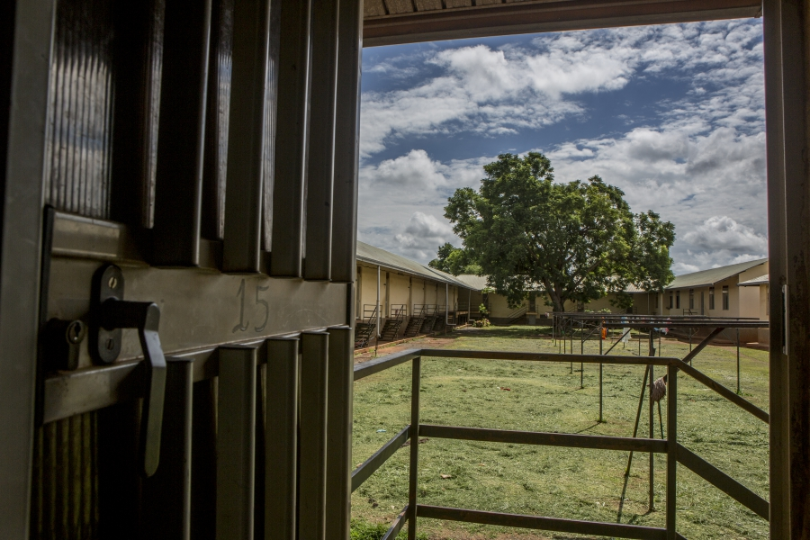 Looking out of a door in the dormitory at St. Monica's Vocational School in Gulu, Uganda.