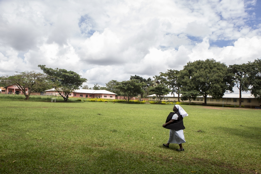 Sister Rosemary striding across the yard at St. Monica Girls'  Vocational School.