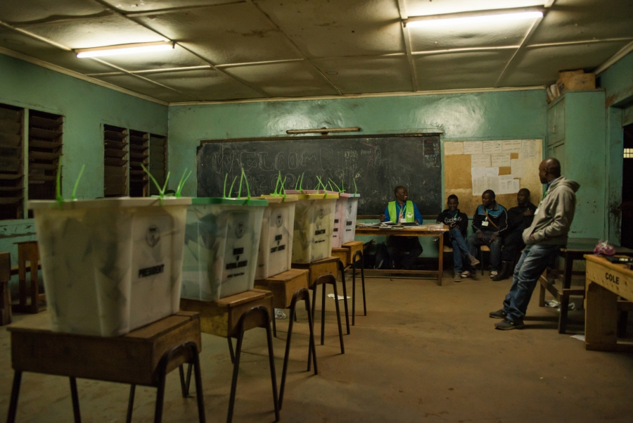 Election officials wait for confirmation to begin counting votes for Kenya's next president in Nairobi, Kenya.
