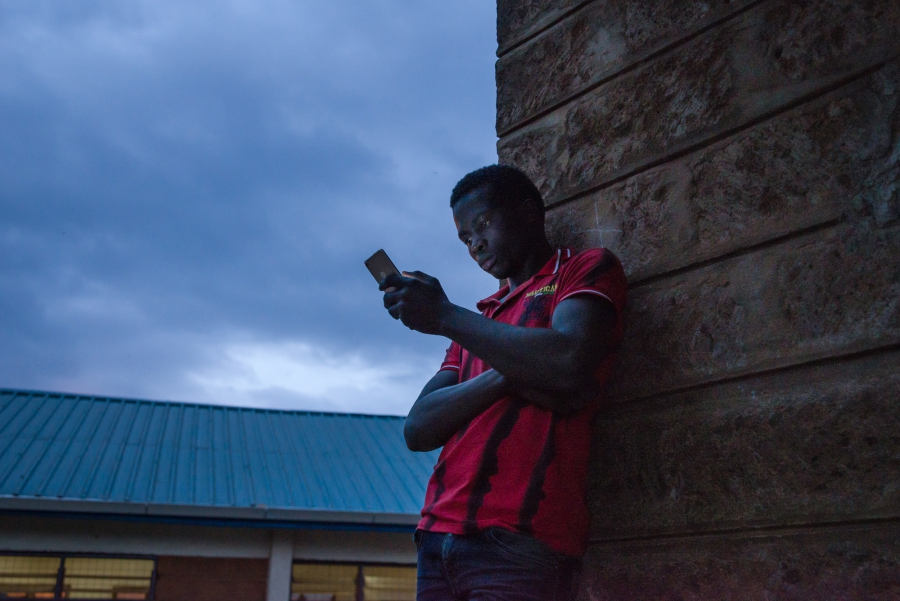 A man waits for voting to end outside a polling station at Olympic Primary School in Nairobi.