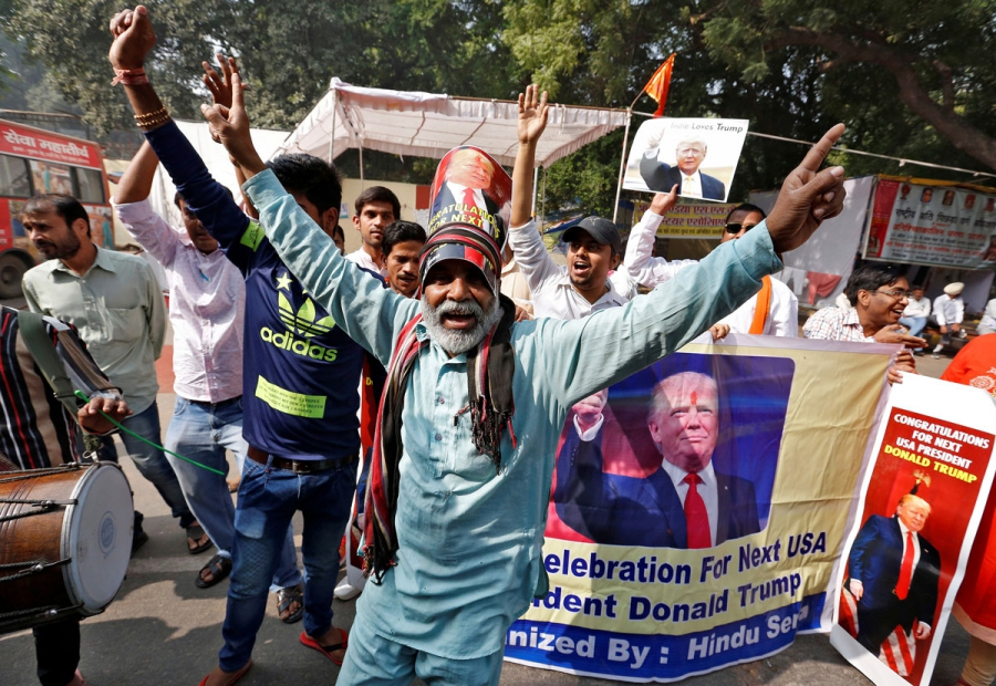 Members of Hindu Sena, a right-wing Hindu group, celebrate Donald Trump's victory in the US election, in New Delhi.
