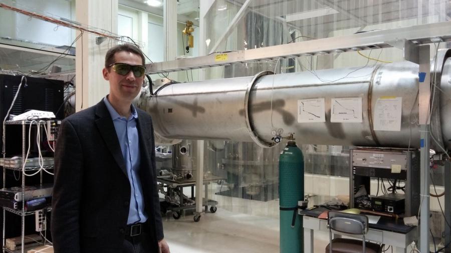 Physicist Matthew Evans at his lab at MIT in Cambridge, Massashusetts.