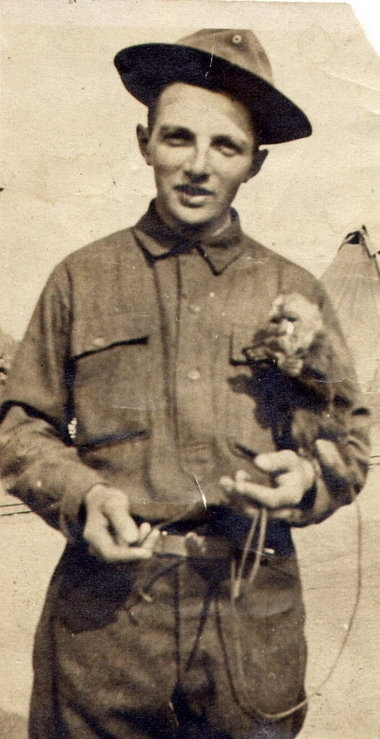"Frank Burke is shown during training in Alabama with his pet monkey ""Jim."""