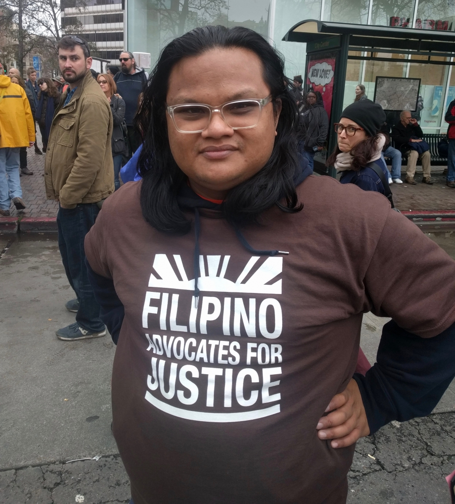 Fred Pinguel, with Filipino Advocates for Justice in Oakland, marching in the Oakland Women's March on 1-21-17