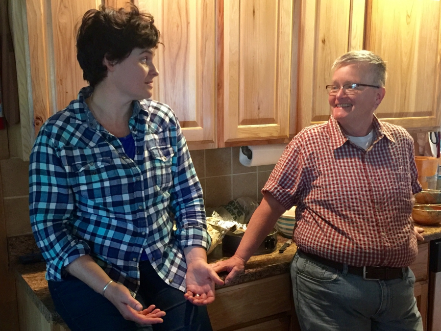Mary Poole (left) and Drew Taylor talk in Poole's kitchen on April 23.