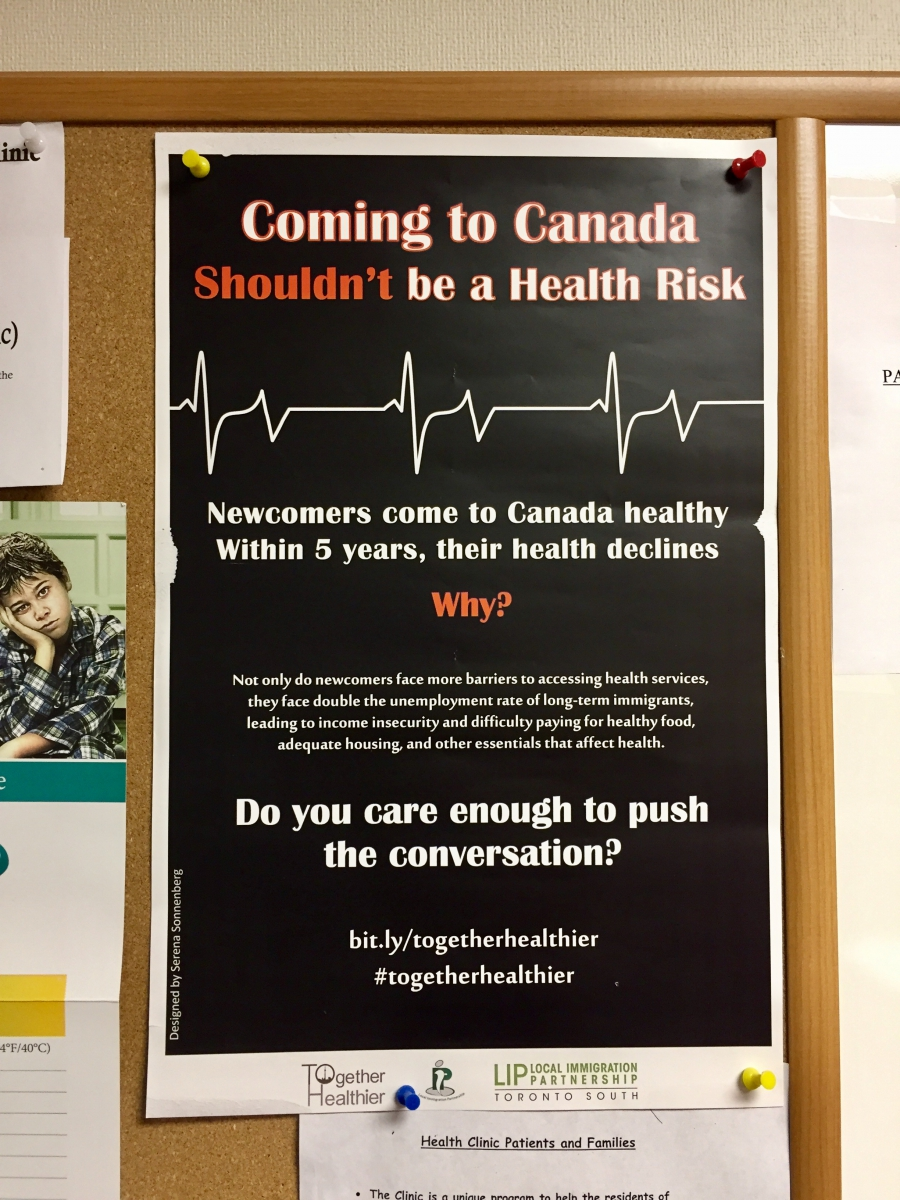 """Coming to Canada shouldn't be a health risk,"" a poster hanging at the enterence to the Canadian Center for Refugee Immigrant Healthcare clinic."